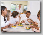 Schoolchildren enjoying their lunch in a school ca
