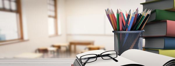 Composite image of school supplies on desk